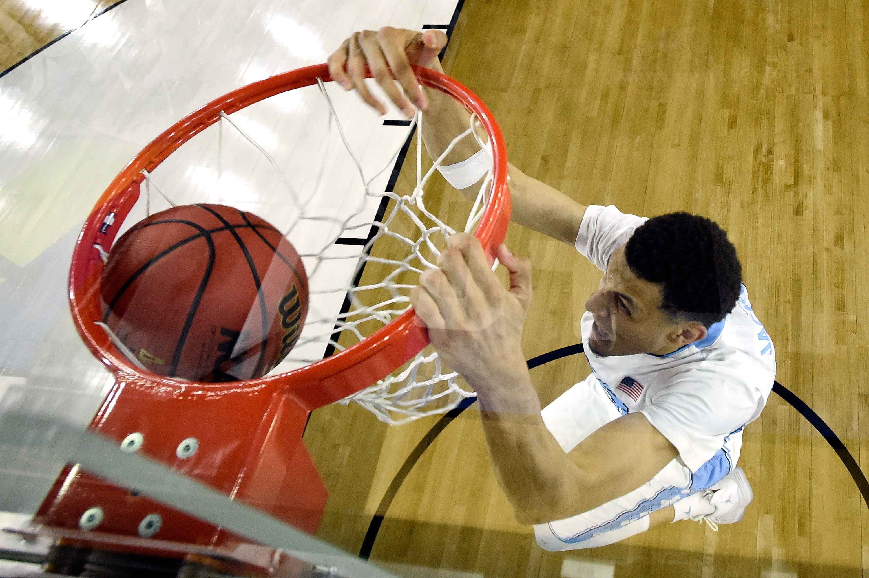 Justin Jackson of the North Carolina Tar Heels dunks the ball in the second half against the Syracuse Orange during the NCAA Men's Final Four Semifinal at NRG Stadium on April 2, 2016 in Houston, Texas.