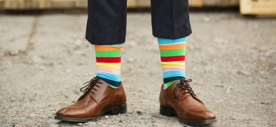 man in fancy, rainbow socks