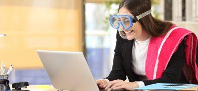 Businesswoman needing vacation booking at job