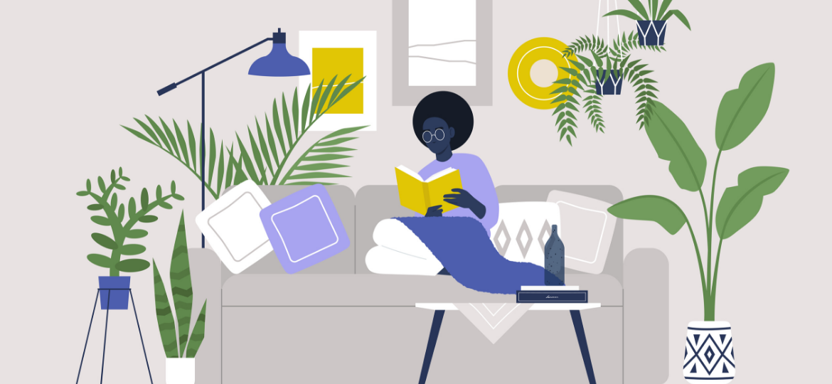 A woman is reading on a couch, surrounded by plants