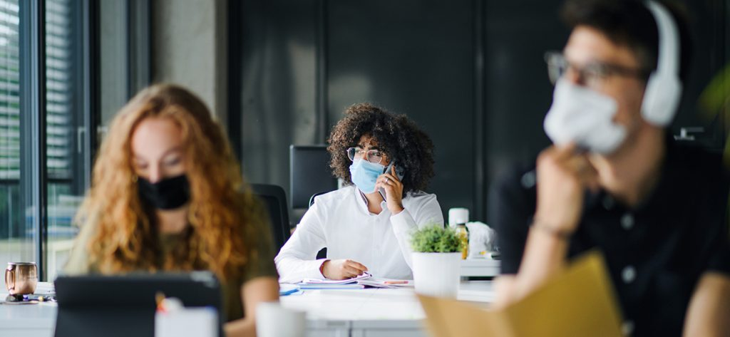 Young people with face masks back on campus amid coronavirus pandemic